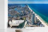Fotobehang vinyl - Luchtfoto van Gold Coast in Australië tijdens een heldere dag breedte 390 cm x hoogte 260 cm - Foto print op behang (in 7 formaten beschikbaar)