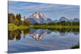 Weerspiegeling van een groen landschap en het Tetongebergte in het water Aluminium 180x120 cm - Foto print op Aluminium (metaal wanddecoratie) XXL / Groot formaat!