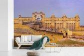 Fotobehang vinyl - Het Fort Amber kleurt geel door de laagstaande zon breedte 450 cm x hoogte 300 cm - Foto print op behang (in 7 formaten beschikbaar)