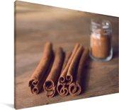 Aromatische kaneelstokjes op een houten tafel Canvas 60x40 cm - Foto print op Canvas schilderij (Wanddecoratie woonkamer / slaapkamer)