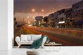Fotobehang vinyl - De straten van Lahore in de nacht breedte 450 cm x hoogte 300 cm - Foto print op behang (in 7 formaten beschikbaar)