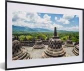 Foto in lijst - Witte wolken boven de Borobudur tempel fotolijst zwart met witte passe-partout 60x40 cm - Poster in lijst (Wanddecoratie woonkamer / slaapkamer)