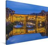 De Ponte Vecchio verlicht in de avond in Italië Canvas 30x20 cm - klein - Foto print op Canvas schilderij (Wanddecoratie woonkamer / slaapkamer)