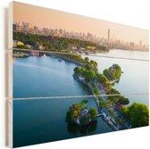 De skyline van het Aziatische Hanoi bij zonsondergang Vurenhout met planken 120x80 cm - Foto print op Hout (Wanddecoratie)