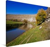 Landschap van Orheiul Vechi in Moldavië met blauwe lucht in Moldavië Canvas 120x80 cm - Foto print op Canvas schilderij (Wanddecoratie woonkamer / slaapkamer)