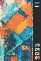 2023: Orange & Blue Abstract Weekly Calendar Planner Organizer