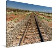 Een spoorweg gefotografeerd tijdens een zonnige middag Canvas 90x60 cm - Foto print op Canvas schilderij (Wanddecoratie woonkamer / slaapkamer)