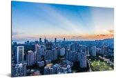 Oranje zonnestralen aan de horizon in Shenzhen Aluminium 60x40 cm - Foto print op Aluminium (metaal wanddecoratie)