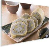 Gesneden plakjes van een heilige lotus op een plankje Plexiglas 30x20 cm - klein - Foto print op Glas (Plexiglas wanddecoratie)