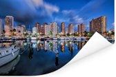 De hotels van Honolulu weerspiegelen in het blauwe water in Hawaï Poster 90x60 cm - Foto print op Poster (wanddecoratie woonkamer / slaapkamer)