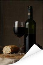 Rode wijn en brood op een tafel Poster 60x90 cm - Foto print op Poster (wanddecoratie woonkamer / slaapkamer)