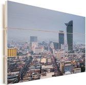 De hoge gebouwen van Phnom Penh in het Aziatische Cambodja Vurenhout met planken 90x60 cm - Foto print op Hout (Wanddecoratie)