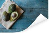 Avocado's op een theekleed Poster 120x80 cm - Foto print op Poster (wanddecoratie woonkamer / slaapkamer)