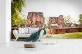 Fotobehang vinyl - Zonlicht op de stenen van Polonnaruwa in Sri Lanka breedte 535 cm x hoogte 300 cm - Foto print op behang (in 7 formaten beschikbaar)