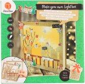 Decotime maak je eigen kerst-lightbox voor kerst van MDF huizen met een boom