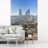 Fotobehang vinyl - Heldere dag in het Aziatische Bakoe in Azerbeidzjan breedte 270 cm x hoogte 400 cm - Foto print op behang (in 7 formaten beschikbaar)