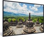 Foto in lijst - Witte wolken boven de Borobudur tempel fotolijst zwart 60x40 cm - Poster in lijst (Wanddecoratie woonkamer / slaapkamer)