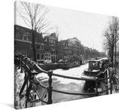 De bevroren Prinsengracht in de winter Canvas 120x80 cm - Foto print op Canvas schilderij (Wanddecoratie woonkamer / slaapkamer)