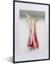 Foto in lijst - Close-up van de stengels van rabarber fotolijst zwart met witte passe-partout 40x60 cm - Poster in lijst (Wanddecoratie woonkamer / slaapkamer)