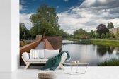 Fotobehang vinyl - Groen landschap in de Nederlandse stad Den Bosch breedte 600 cm x hoogte 400 cm - Foto print op behang (in 7 formaten beschikbaar)