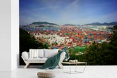 Fotobehang vinyl - Containers van de Sinseondae Pier in het Zuid-Koreaanse Busan breedte 420 cm x hoogte 280 cm - Foto print op behang (in 7 formaten beschikbaar)