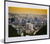 Foto in lijst - Het Chinese Guiyang bij zonsopkomst in Azië fotolijst zwart met witte passe-partout klein 40x30 cm - Poster in lijst (Wanddecoratie woonkamer / slaapkamer)