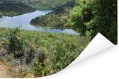 Uitzicht op een knalblauwe rivier in het Spaanse Nationaal park Monfragüe Poster 120x80 cm - Foto print op Poster (wanddecoratie woonkamer / slaapkamer)