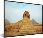 Foto in lijst - De Sfinx van Gizeh met oranje tinten in Egypte fotolijst zwart 40x30 cm - Poster in lijst (Wanddecoratie woonkamer / slaapkamer)