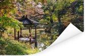 Een paviljoen naast een vijver in de tuin met mooie bomen bij Changdeokgung Poster 180x120 cm - Foto print op Poster (wanddecoratie woonkamer / slaapkamer) XXL / Groot formaat!