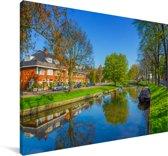 Schitterende lente dag in de Nederlandse stad Haarlem Canvas 140x90 cm - Foto print op Canvas schilderij (Wanddecoratie woonkamer / slaapkamer) / Europese steden Canvas Schilderijen