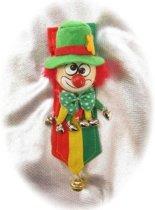 Broche clown op banner
