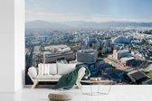 Fotobehang vinyl - Uitzicht op de moderne Japanse stad Fukuoka breedte 330 cm x hoogte 220 cm - Foto print op behang (in 7 formaten beschikbaar)