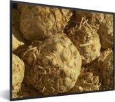 Foto in lijst - Hoopje gele knolselderij fotolijst zwart 40x30 cm - Poster in lijst (Wanddecoratie woonkamer / slaapkamer)