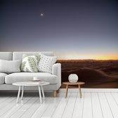 Fotobehang vinyl - Schemering boven de woestijn Erg Chebbi in Marokko breedte 375 cm x hoogte 280 cm - Foto print op behang (in 7 formaten beschikbaar)