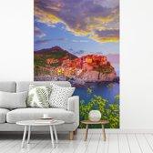 Fotobehang vinyl - Oranje gekleurde huizen door de ondergaande zon in Cinque Terre breedte 270 cm x hoogte 400 cm - Foto print op behang (in 7 formaten beschikbaar)