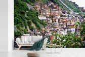 Fotobehang vinyl - Een nederzetting van een favela op een heuvel in Rio de Janeiro breedte 540 cm x hoogte 360 cm - Foto print op behang (in 7 formaten beschikbaar)