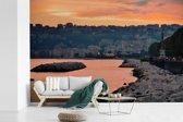 Fotobehang vinyl - Oranje lucht boven Napels in Italië breedte 360 cm x hoogte 240 cm - Foto print op behang (in 7 formaten beschikbaar)