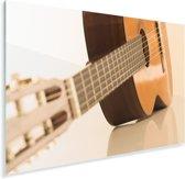 Een Akoestische gitaar ligt op de zij Plexiglas 90x60 cm - Foto print op Glas (Plexiglas wanddecoratie)