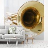 Fotobehang vinyl - Een close up van een gouden trompet breedte 260 cm x hoogte 260 cm - Foto print op behang (in 7 formaten beschikbaar)
