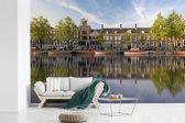 Fotobehang vinyl - Prinsengracht in het centrum van Amsterdam breedte 450 cm x hoogte 300 cm - Foto print op behang (in 7 formaten beschikbaar)