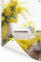 Mimosa bloemen op een bruine ondergrond Tuinposter 60x90 cm - Tuindoek / Buitencanvas / Schilderijen voor buiten (tuin decoratie)