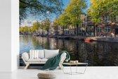 Fotobehang vinyl - De Prinsengracht in het centrum van Amsterdam breedte 450 cm x hoogte 300 cm - Foto print op behang (in 7 formaten beschikbaar)