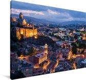 Overzicht over de stad Tbilisi in de avond Canvas 90x60 cm - Foto print op Canvas schilderij (Wanddecoratie woonkamer / slaapkamer)