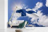 Fotobehang vinyl - Vlag van Finland op een zonnige dag breedte 420 cm x hoogte 280 cm - Foto print op behang (in 7 formaten beschikbaar)