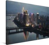 Gebouwen in het Aziatische Pyongyang in de avond Canvas 180x120 cm - Foto print op Canvas schilderij (Wanddecoratie woonkamer / slaapkamer) XXL / Groot formaat!