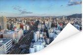 Een fantastische blauwe lucht boven Sapporo-shi Poster 180x120 cm - Foto print op Poster (wanddecoratie woonkamer / slaapkamer) / Aziatische steden Poster XXL / Groot formaat!