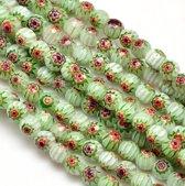Millefiori glas, Venetië, licht gefacetteerde kralen van 6mm in de kleuren groen, wit, geel, rood en blauw. Verkocht per streng van ca. 40cm (ca. 66 kralen)