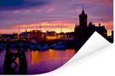 Een kleurrijke hemel bij het hoofdgebouw van de Welshe pier in Cardiff Poster 60x40 cm - Foto print op Poster (wanddecoratie woonkamer / slaapkamer) / Europese steden Poster