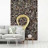 Fotobehang vinyl - Zwarte boekweit korrels en een houten lepel breedte 260 cm x hoogte 400 cm - Foto print op behang (in 7 formaten beschikbaar)