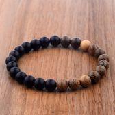 Houten armband met zwarte en bruine kralen
